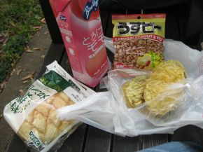 Picnic lunch: Melon bread, peach juice, roasted peanuts, tempura